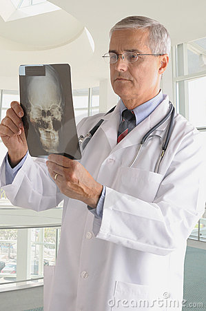 Middle Aged Doctor in Lab Coat with X-ray