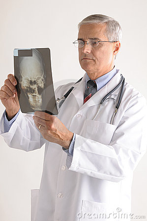 Free Middle Aged Doctor Looking At An X-Ray Royalty Free Stock Photo - 12340125