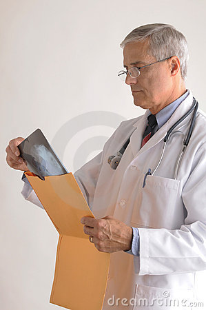 Free Middle Aged Doctor Looking At An X-Ray Stock Image - 12388741