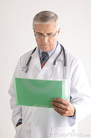 Middle Aged Doctor Looking at Patients Chart
