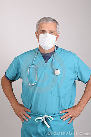Middle aged Doctor in Scrubs with Hands on Hips