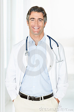 Middle aged doctor standing with hands in pockets