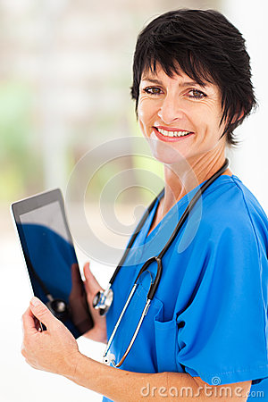 Middle aged doctor tablet