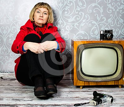 Middle aged lady sitting on old floor