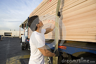 Middle Aged Male Worker Pulling Trailer Belt