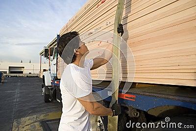 Middle Aged Male Worker Pulling Trailer Belt