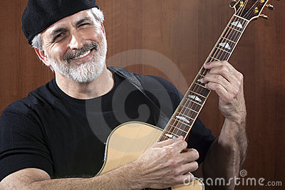 Middle-Aged Man With Acoustic Guitar