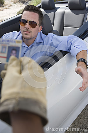 Middle Aged Man In Car Gesturing