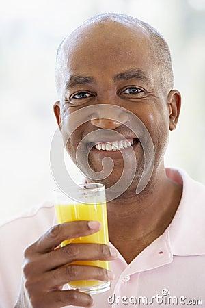 Middle Aged Man Drinking Fresh Orange Juice