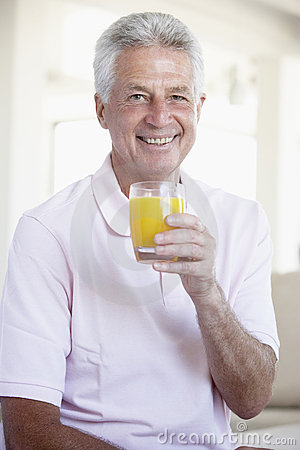 Middle Aged Man Drinking Orange Juice