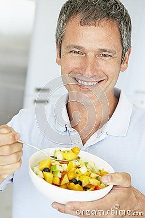 Middle Aged Man Eating Fresh Fruit Salad