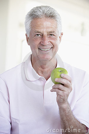 Middle Aged Man Eating Green Apple