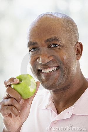 Free Middle Aged Man Eating Green Apple Royalty Free Stock Photos - 7875708