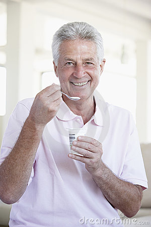 Middle Aged Man Eating Yogurt