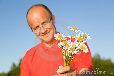 Middle-aged man giving flowers