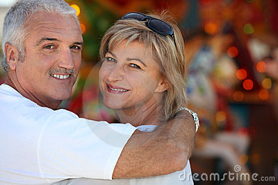 Middle aged man with his arm around his wife