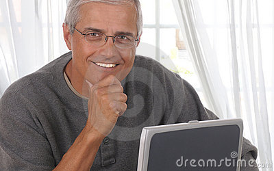 Middle Aged Man in Living room with computer