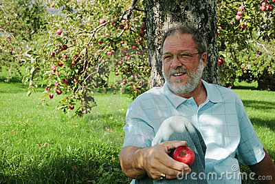 Middle aged man in orchard