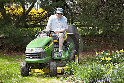 Middle-Aged Man on Riding Lawn Mower