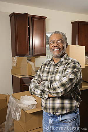 Middle-aged Man Standing In Kitchen With Boxes. Stock Photo - Image: 2043840