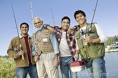 Middle-aged man with three sons on fishing trip