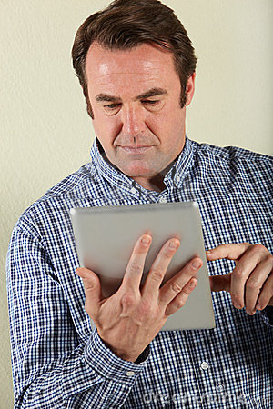 Middle Aged Man Using Tablet Computer