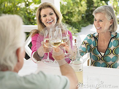 Middle Aged People Toasting Wine Glasses Outdoors