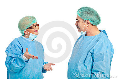 Middle aged surgeons having conversation