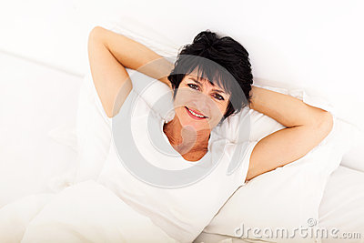 Middle aged woman bed