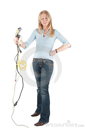 Middle aged woman with cables and plugs
