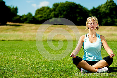Middle aged woman doing meditation