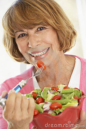 Middle Aged Woman Eating A Fresh Green Salad