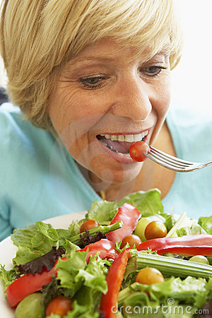 Middle Aged Woman Eating Healthy Salad