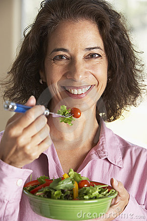 Middle Aged Woman Eating A Salad