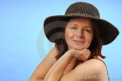 Middle-aged woman in hat
