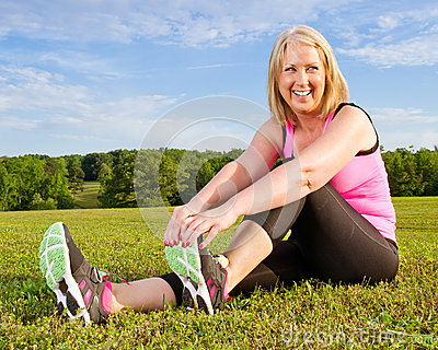 Middle-aged woman in her 40s stretching