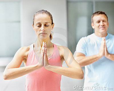 Middle aged woman practicing yoga together