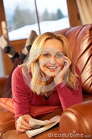 Free Middle Aged Woman Reading Magazine Lying On Sofa Royalty Free Stock Photo - 25641045