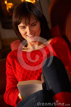 Middle Aged Woman Relaxing With Book