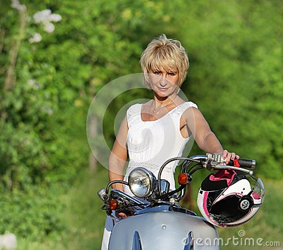 Middle aged woman on scooter