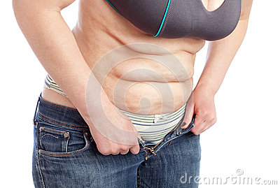 Middle-aged woman shows belly with excess fat.