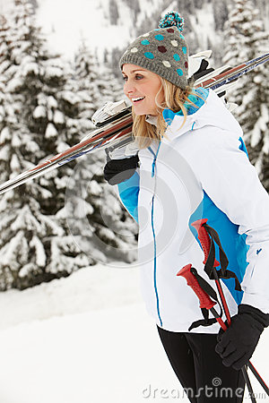 Middle Aged Woman On Ski Holiday In Mountains