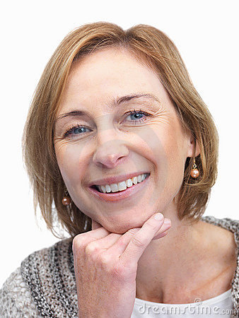 Middle aged woman smiling over white backgrou