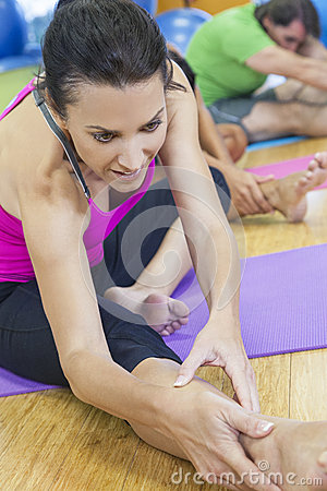 Middle Aged Woman Stretching Practicing Yoga