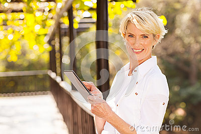 Middle aged woman tablet