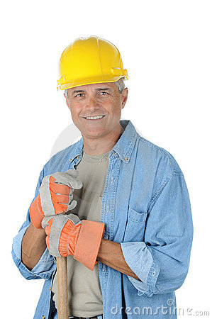 Middle aged Worker holding onto shovel handle