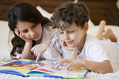 A Middle Eastern brother and sister reading