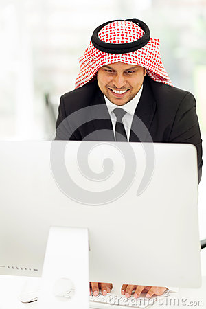 Middle eastern businessman computer