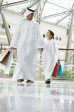 A Middle Eastern man and his son shopping