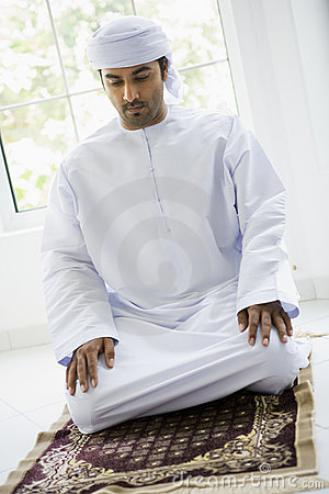 A Middle Eastern man praying